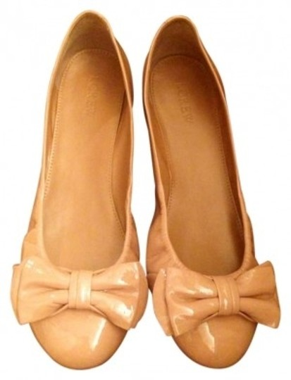 Preload https://item1.tradesy.com/images/jcrew-nude-patent-leather-bow-flats-size-us-85-143630-0-0.jpg?width=440&height=440