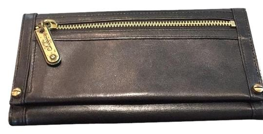 Preload https://img-static.tradesy.com/item/14371285/cole-haan-black-leather-exterior-2-pockets-for-cash-and-other-items-wallet-0-2-540-540.jpg