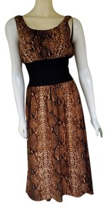 Calvin Klein short dress Brown Snakeskin on Tradesy