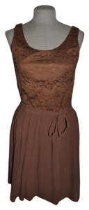 Forever 21 short dress Dk Camel Accordion Pleated Pleated Date Night Resort on Tradesy