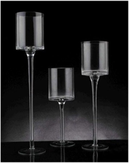 Preload https://item3.tradesy.com/images/clear-glass-candle-holder-sets-of-3-reception-decoration-143997-0-0.jpg?width=440&height=440
