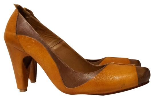 Preload https://item5.tradesy.com/images/brown-and-tan-italy-wrapped-leather-high-heel-pumps-size-us-75-regular-m-b-1440029-0-0.jpg?width=440&height=440