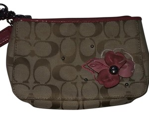 Coach Wristlet in Tan And coral Pink