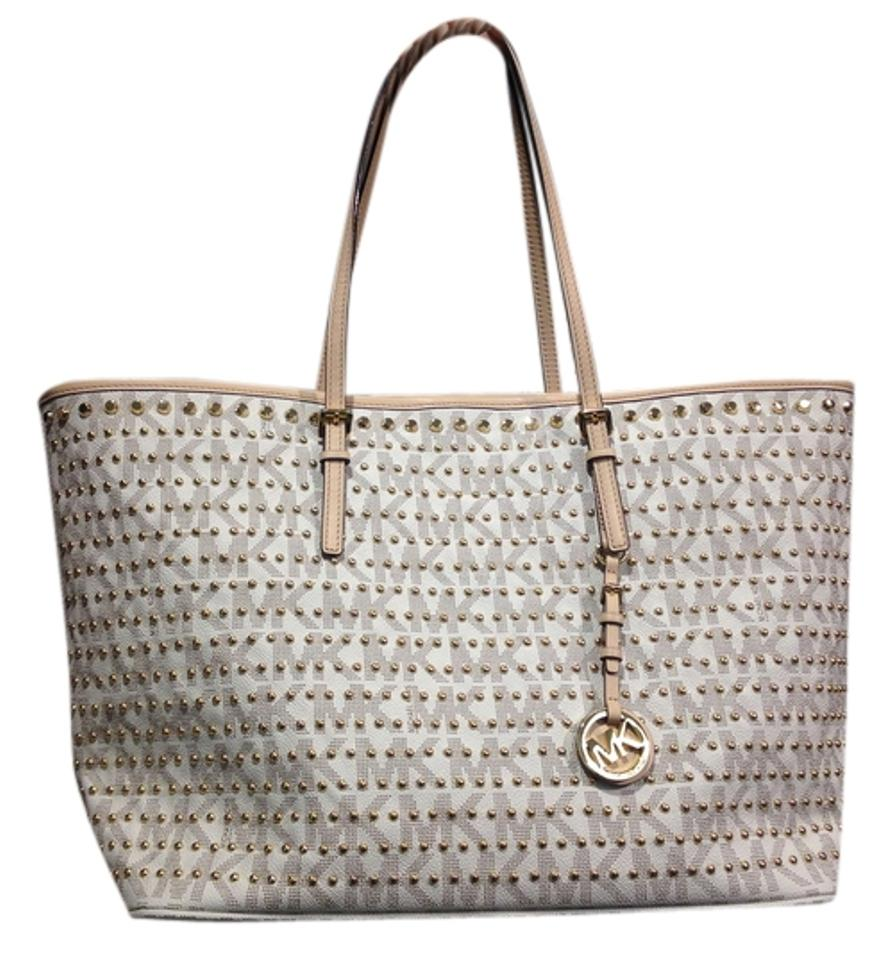 fe84c26546d1 Michael Kors Pvc Signature Studded Tote in Vanilla Image 0 ...