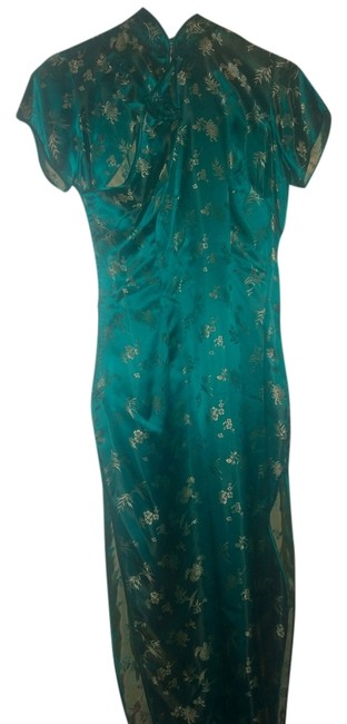 Preload https://item2.tradesy.com/images/green-and-gold-rayon-unlined-long-casual-maxi-dress-size-8-m-1442231-0-0.jpg?width=400&height=650