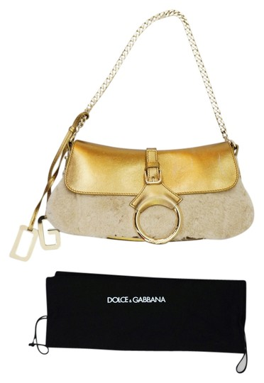 Preload https://item2.tradesy.com/images/dolce-and-gabbana-metallic-shoulder-with-and-chain-purse-gold-leatherfur-baguette-1443426-0-0.jpg?width=440&height=440