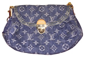 One of a KIND ....Louis Vuitton DENIM CLUTCH .... Great for a night out on the town ... Also comes with a shoulder strap so that it can be worn as a purse Denim Blue Clutch