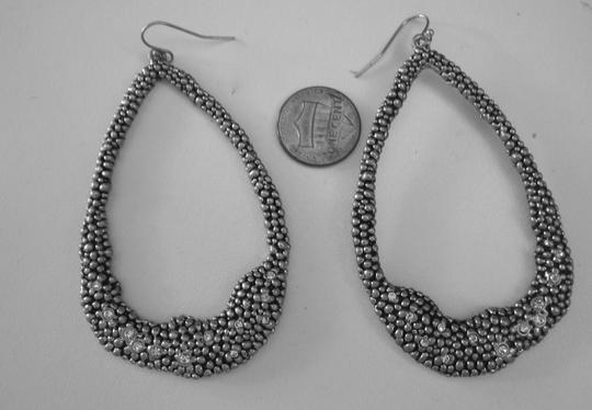 Other Long oval dangle sparkly earrings