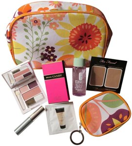 Clinique Brand new Clinique bundle deal includes 1 Large cosmetic bag, 1 small coin and keychain purse, makeup, skincare and Prada Candy Fragrance sample!