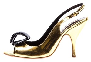 Rupert Samuelson Gold Pumps