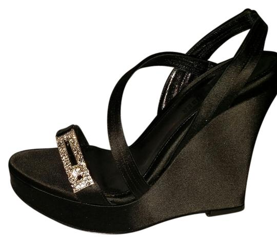 Preload https://img-static.tradesy.com/item/14493124/judith-leiber-black-satin-wedges-size-us-6-regular-m-b-0-1-540-540.jpg