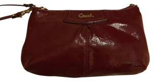 Coach Wristlet in Red/burgundy