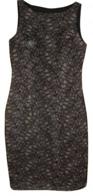 Preload https://item2.tradesy.com/images/carmen-marc-valvo-black-classy-but-sexy-signature-above-knee-cocktail-dress-size-6-s-145156-0-0.jpg?width=400&height=650