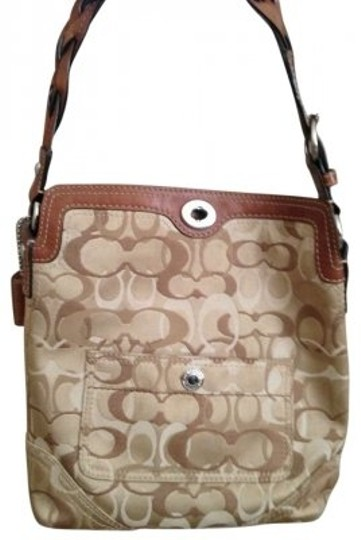 Preload https://item1.tradesy.com/images/coach-purse-bucket-hobo-designer-purse-pattern-braided-brown-tan-cream-leather-and-cloth-shoulder-ba-145225-0-0.jpg?width=440&height=440