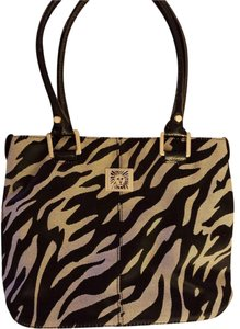AK Anne Klein Gold Logo Animal Fabric Outside Pocket Inside Zip Pocket Tote in Black and beige zebra print, patent leather straps and bottom