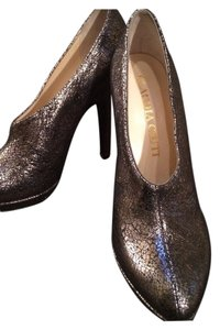 Claudia Ciuti Silver Pumps