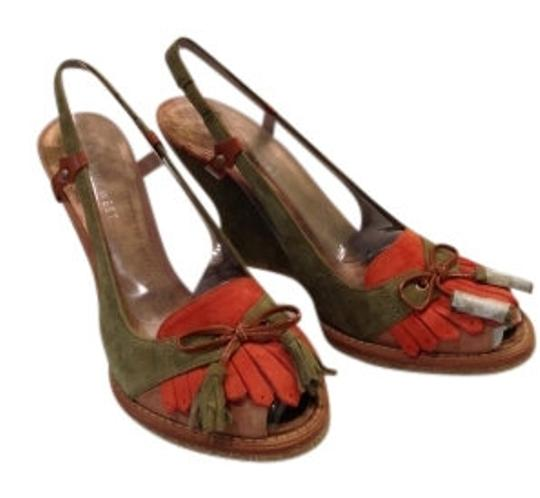 Preload https://item4.tradesy.com/images/nine-west-olive-green-pumpkin-orange-tan-cognac-suede-75-b-new-wedges-size-us-75-regular-m-b-14528-0-0.jpg?width=440&height=440