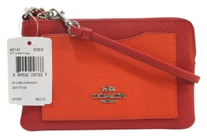 Coach 889532057337 Wristlet in Red / Orange