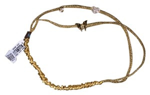 Tadashi Gold Tadashi headband. Elastic shimmering Gold covered with three charms- Heart, butterfly and a large rhinestone.