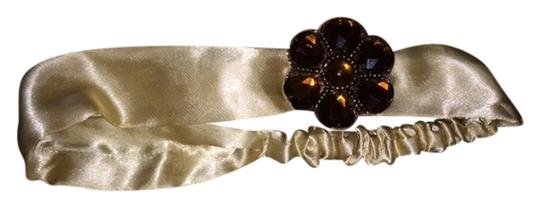 Other Tan stretch headband with brown stone gem accent