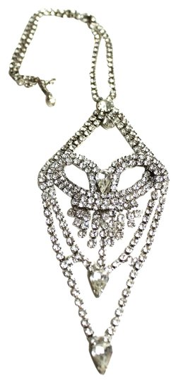 Preload https://item1.tradesy.com/images/silver-and-rhinestone-vintage-heart-shaped-long-necklace-1453560-0-0.jpg?width=440&height=440