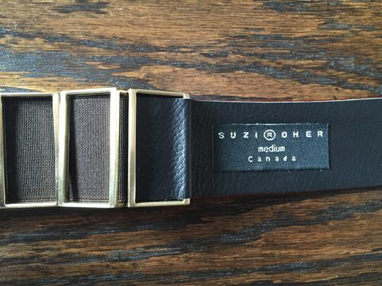 Suzi Roher Patent leather belt with brass accents