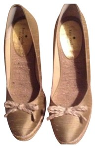 Kate Spade Soft spun gold Wedges
