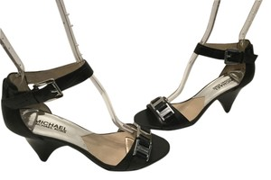 MICHAEL Michael Kors Embossed Ankle Strap Silver Metal Plates Stacked Wood Heels Black leather Sandals