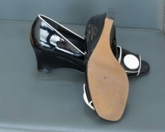 Etienne Aigner Black with white trim Wedges