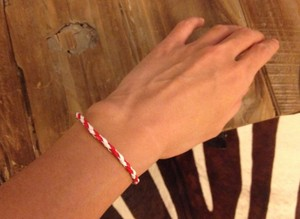 Preload https://item2.tradesy.com/images/anthropologie-white-red-new-handmade-friendship-skinny-thin-faux-leather-cord-gift-bracelet-1458416-0-0.jpg?width=440&height=440