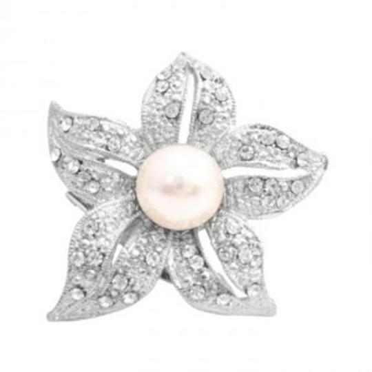 Preload https://item2.tradesy.com/images/silver-ivory-brilliant-prong-set-clear-round-rhinestone-embedded-five-petals-broochpin-145881-0-0.jpg?width=440&height=440