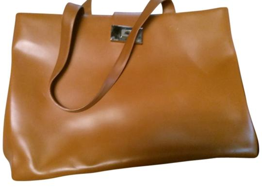 Preload https://img-static.tradesy.com/item/14590441/coccinelle-large-tan-leather-tote-0-1-540-540.jpg