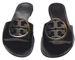 Tory Burch Black with silver emblem Sandals
