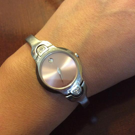 Movado pink faced diamond ladies watch Normal everyday wear and tear, looks very nice. Fits small wrist. Sparkling 6 diamonds looks stunning! Is selling this item because i have too many watch Movado Image 2