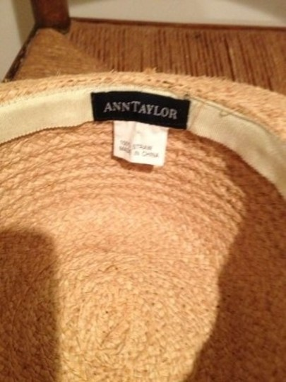 Ann Taylor Classic Ann Taylor straw wide brimmed hat. Trimmed with a black and white grosgrain ribbon.
