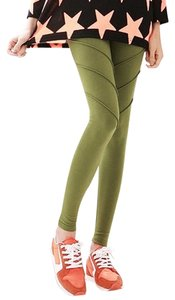 other high waisted green yoga leggings with triple seam detail on the thigh for a ribbed look