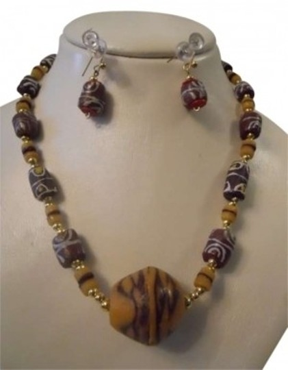 Preload https://item1.tradesy.com/images/brown-multi-hand-made-safrican-necklace-and-earrings-146185-0-0.jpg?width=440&height=440