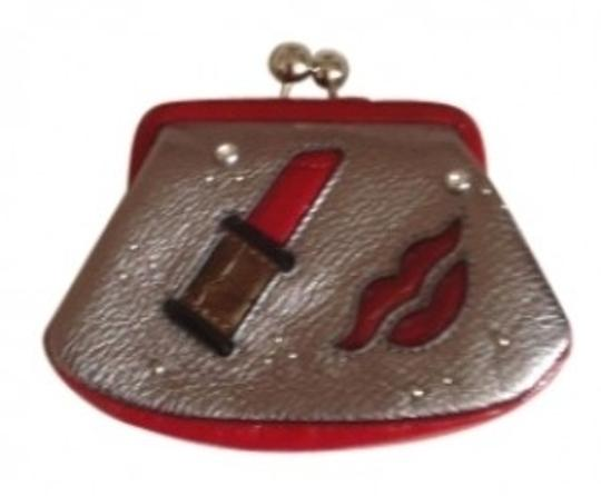 Preload https://item1.tradesy.com/images/brighton-silver-and-red-lipstick-case-cosmetic-bag-146215-0-0.jpg?width=440&height=440