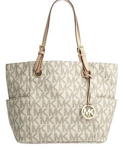 86489e8ba55e Added to Shopping Bag. Michael Kors Mk Monogram Leather Tote in Vanilla. Michael  Kors Signature Jet Set Travel East/West ...