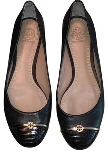 Tory Burch Black with gold trim. Flats