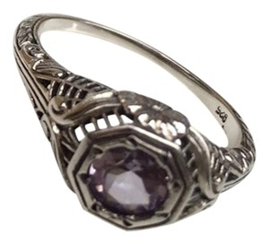 Sterling Silver Filigree Ring with Amethyst Center Stone.