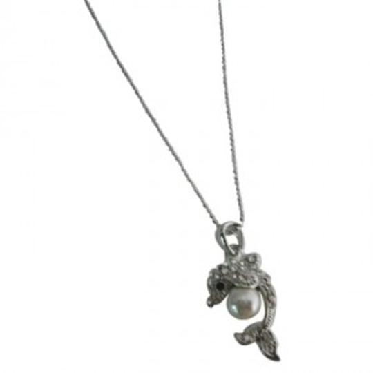 Preload https://img-static.tradesy.com/item/146629/silver-dolphin-pendant-holding-ball-stunning-dolphin-pendant-necklace-jewelry-set-0-0-540-540.jpg