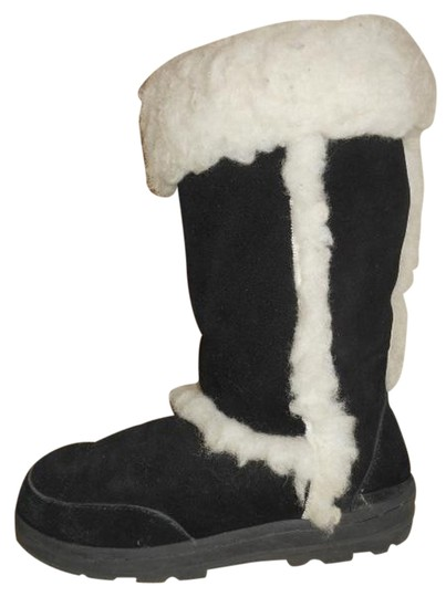 Preload https://item3.tradesy.com/images/emu-black-and-white-suede-bootsbooties-size-us-7-regular-m-b-1468897-0-0.jpg?width=440&height=440