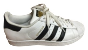 ‼️SOLD‼️ adidas Black ,white and gold. Athletic