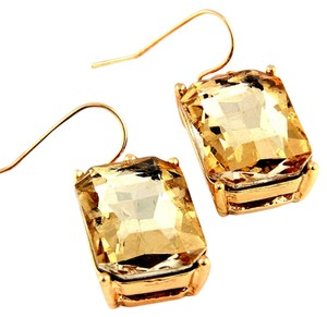 Nine vibrant golden crystal drop earrings