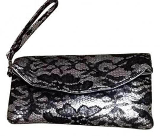 Preload https://item1.tradesy.com/images/black-and-silver-leather-lace-clutch-147245-0-0.jpg?width=440&height=440