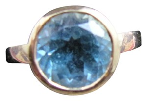 german designer Bold Bezel Set Topaz ring