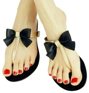 Jelly Thong Bow Black and Gold Sandals