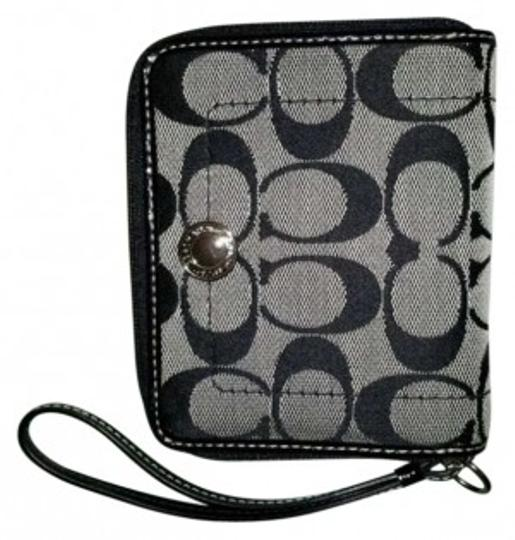 Preload https://item1.tradesy.com/images/coach-black-with-signature-c-s-nwot-kyra-medium-zip-wallet-never-used-wallet-147420-0-0.jpg?width=440&height=440