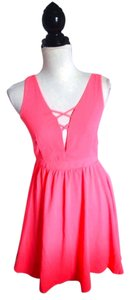 C. Luce short dress Coral Highlighter Bright Orange V-neck Open Back Backless Skater Skater Cute on Tradesy